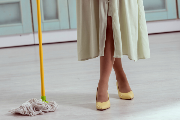 woman in retro dress mopping