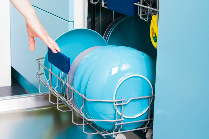dishwasher full of clean blue dishes