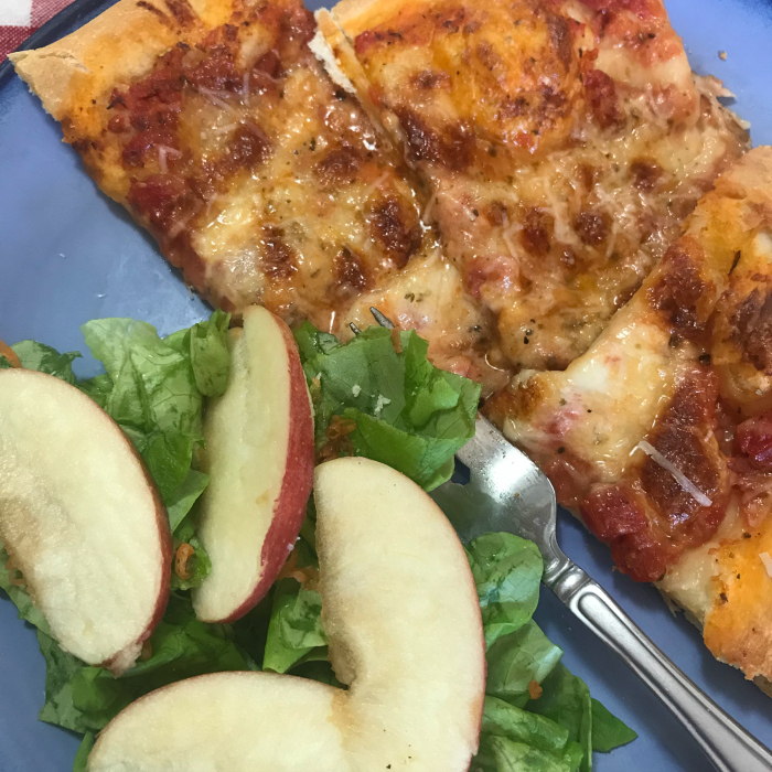 pizza and apple salad on plate