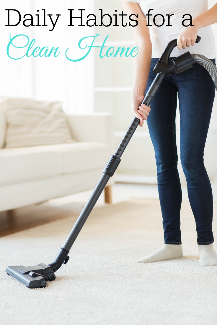 close up of woman with vacuum cleaner cleaning carpet at home