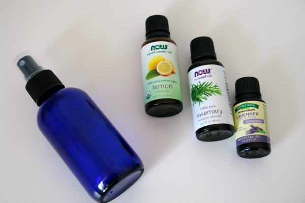 blue spray bottle and essential oil bottles