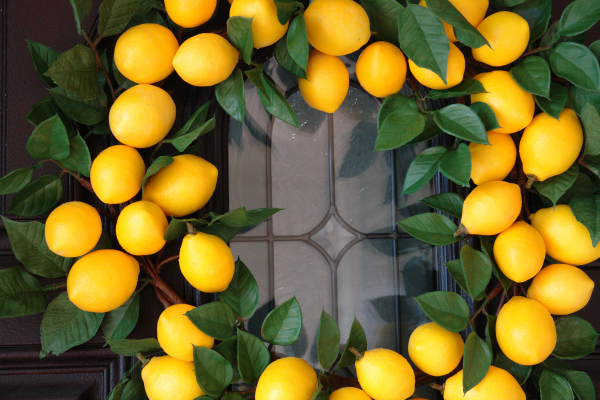 lemon wreath on brown front door