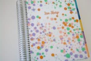 Oh Joy Erin Condren cover on planner on desk