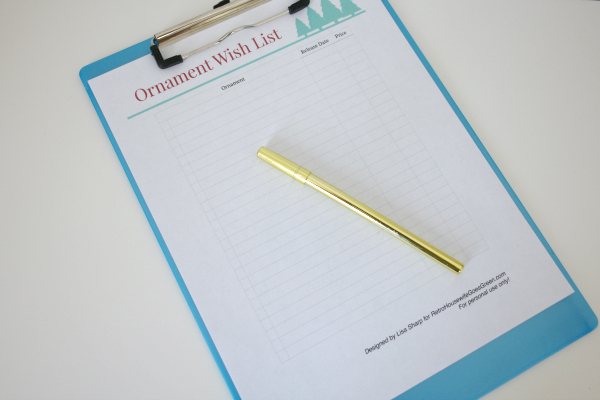 ornament wish list on clipboard with pen