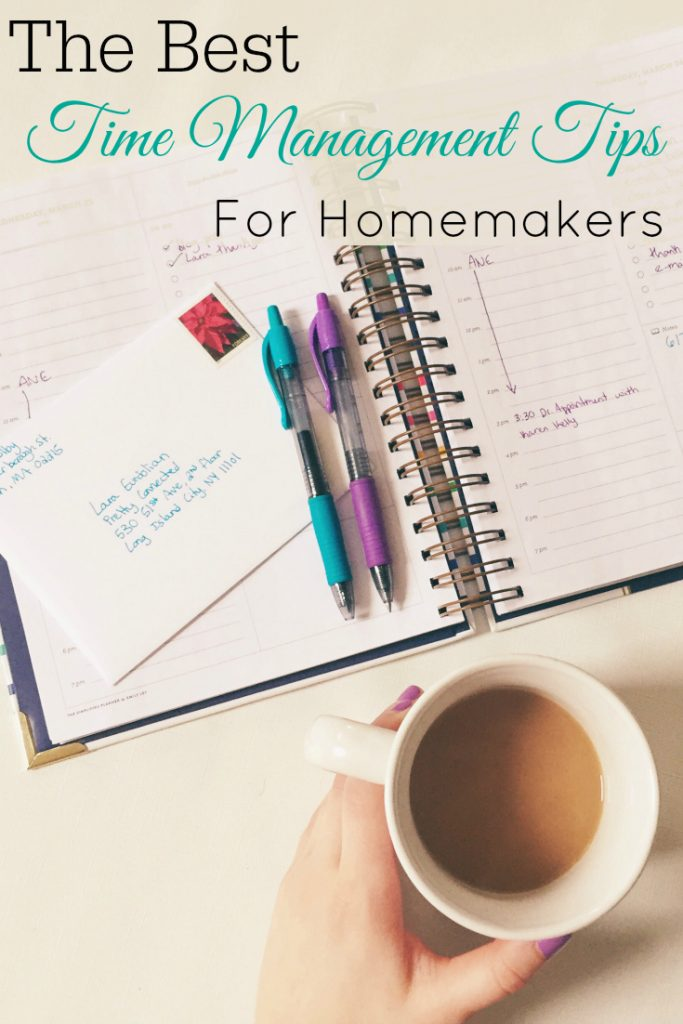 planner, pens, and a hand holding a cup of coffee