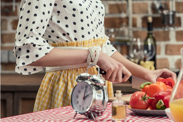 retro housewife chopping veggies with clock