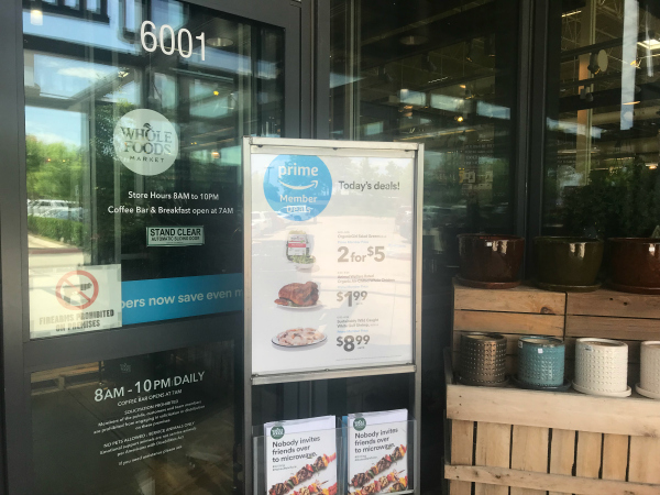 outside of Whole Foods, Amazon Prime sign