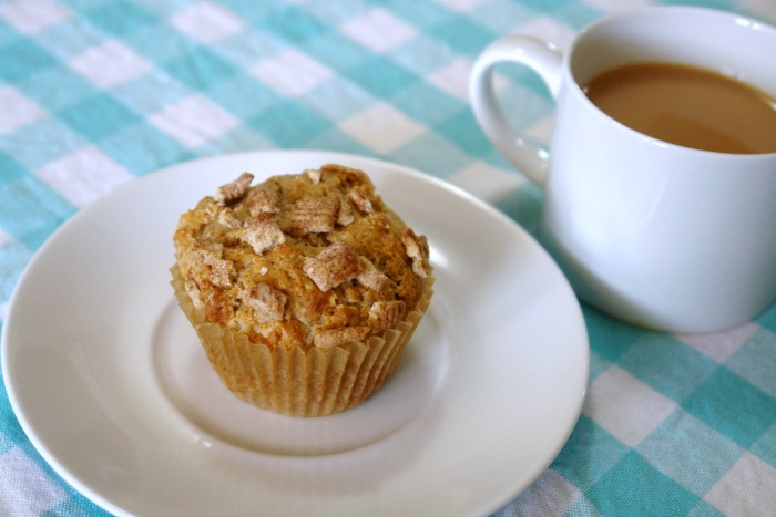 cinnamon muffin on plate with cup of coffee