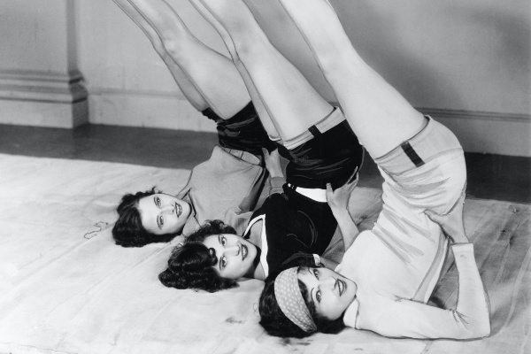 black and white photo of retro women working out