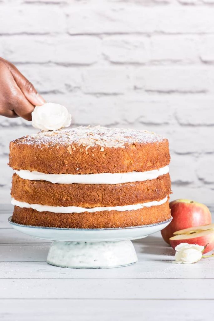 Almond Cardamon Cake on white cake stand