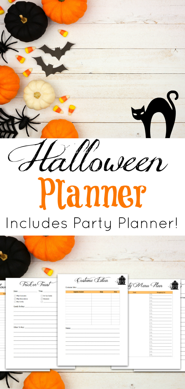 white wooden background with pumpkins, bats, candy and other halloween treats and halloween planner