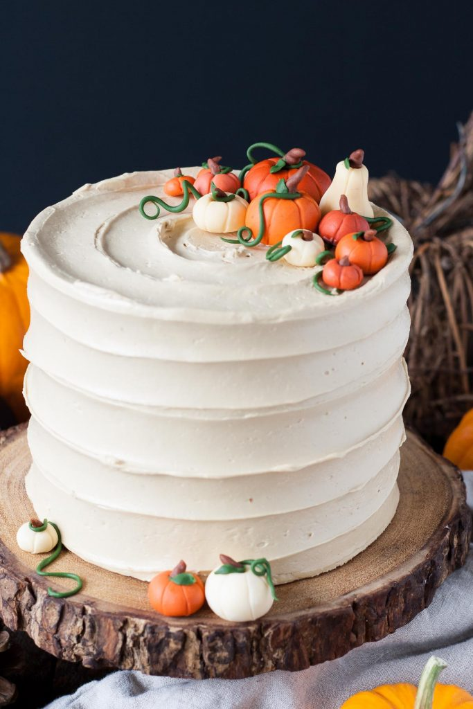 Pumpkin spice latte cake with pumpkin decorations