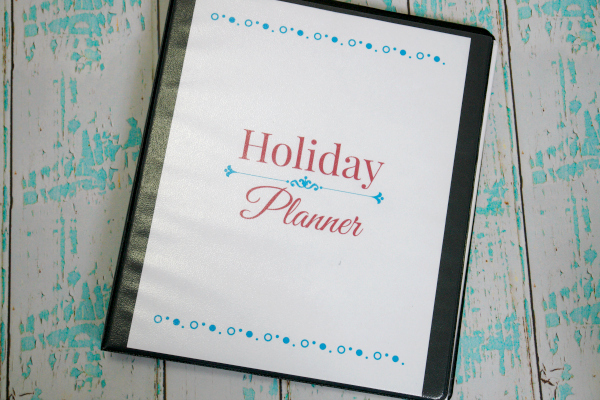 holiday binder on aqua and white wooden background
