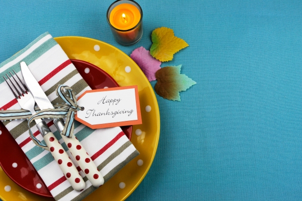 Bright, modern Happy Thanksgiving dining table setting in red, yellow and aqua