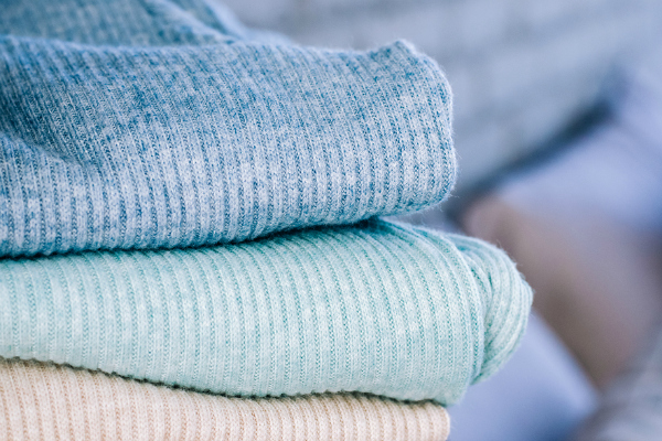 Four sweaters shot close up.