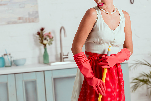 woman in red apron and gloves mopping