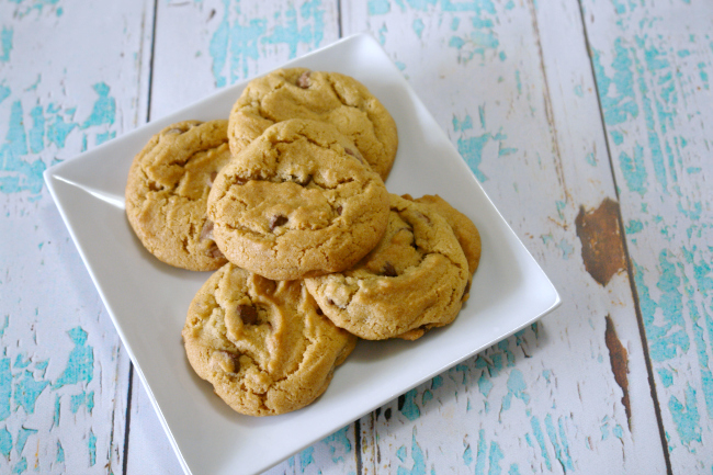 brown butter chocolate chip cookies on white plate on aqua and white wood background