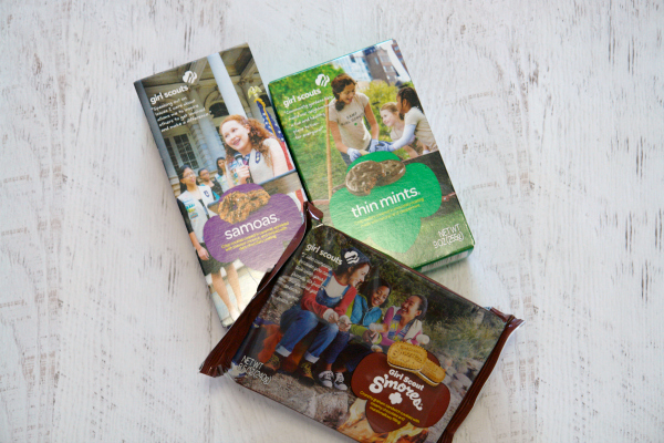 Boxes of Girl Scout cookies on white wooden background