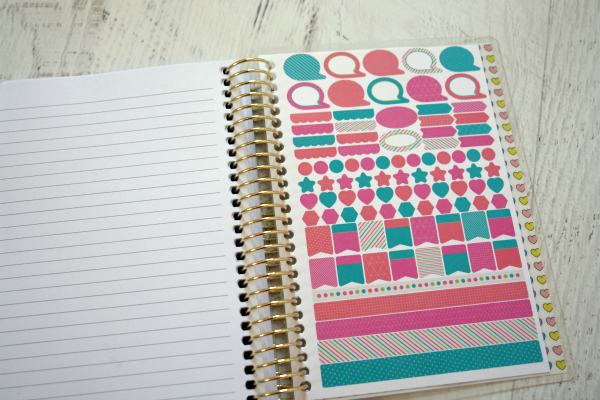 Recollections planner open to show sticker sheet