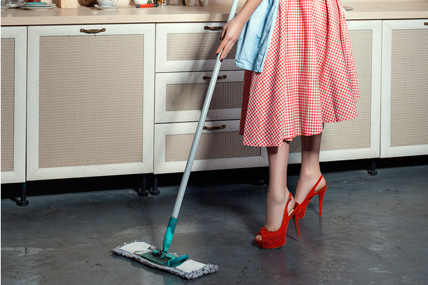 1950s housewife mopping the floor