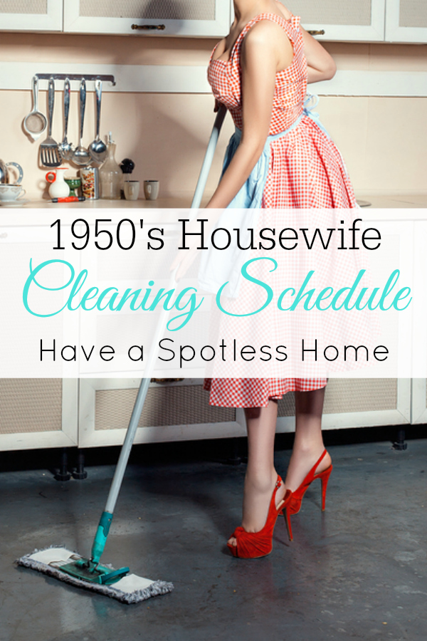 1950's housewife in an apron in the kitchen washing the floor mop.