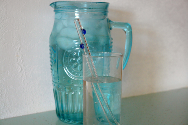 aqua water pitcher and glass of water with glass straw