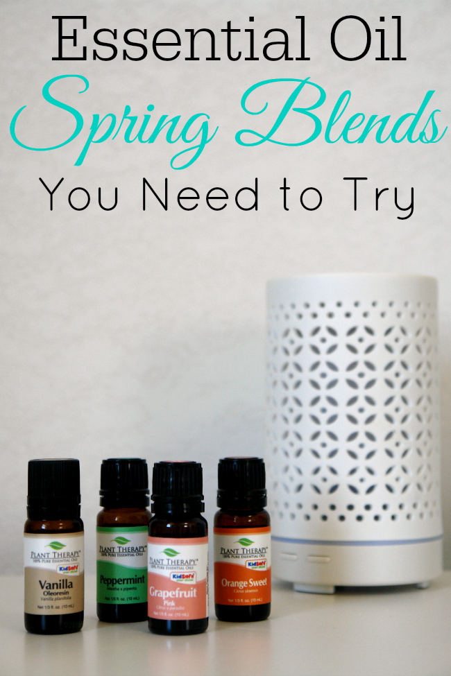 essential oils to use in spring diffuser blends on table with white diffuser
