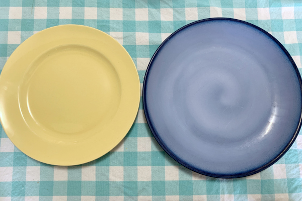 yellow vintage plate and blue modern plate on table