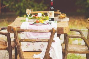 Lunch in the garden with wine and fruit.