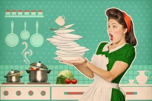 clumsy housewife dropping plates in kitchen