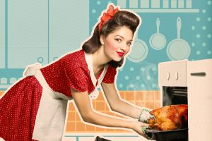 retro housewife putting turkey in oven