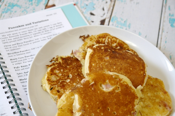 ham and cheese pancakes on plate with open cookbook