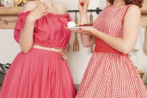 1950s housewives eating treats in kitchen