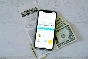 iPhone with Fetch Rewards, receipt, and money