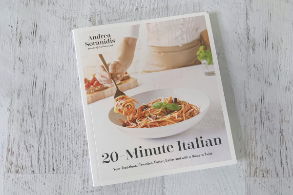 20-Minute Italian Cookbook on white wooden background