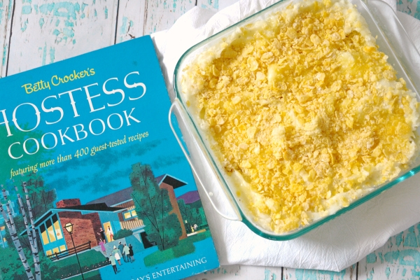 cheesy potato casserole with vintage cookbook