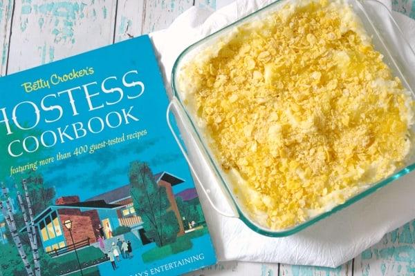 cheesy potato casserole with vintage cookbook