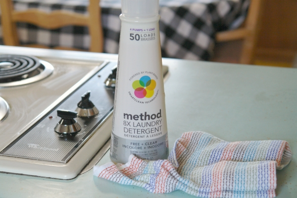 method laundry soap on counter top with dishrag