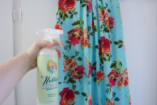 putting wrinkle releaser on dress