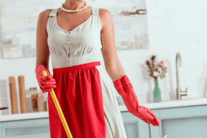1950s woman in white dress and red apron
