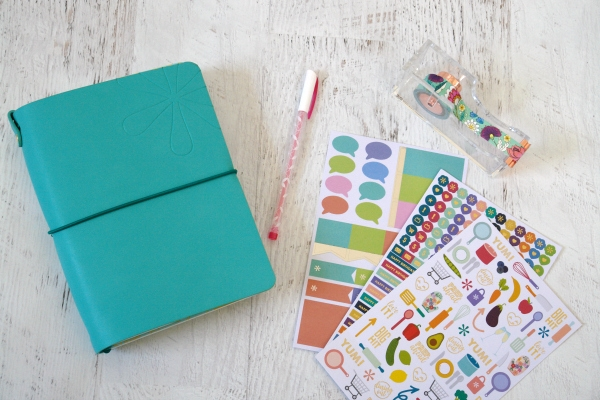 Erin Condren folio, sticks and washi on white table