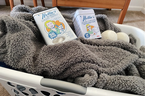 laundry and laundry detergent and brightener in laundry basket