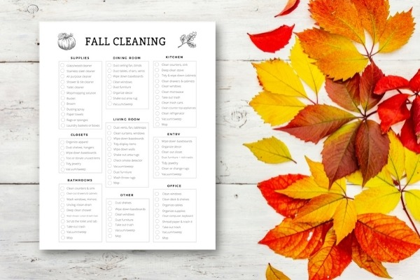 fall cleaning checklist on table with fall leaves