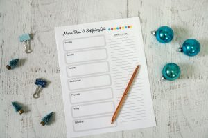 meal planning sheet on white table with christmas decor