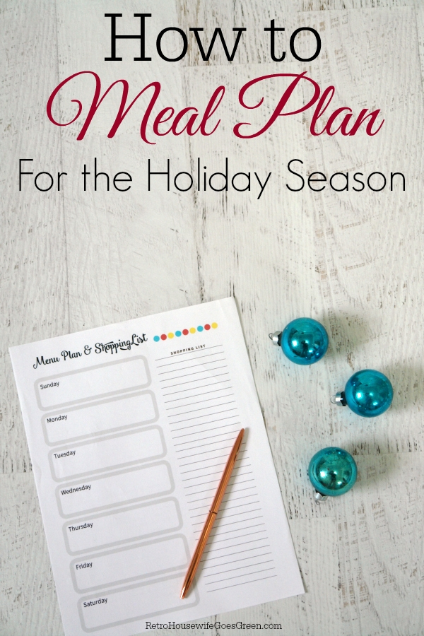 meal planning sheet on white table with turquoise ornaments and pen