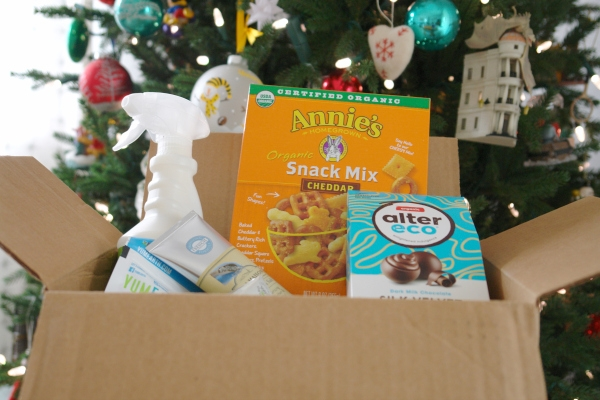 box of products from iHerb in front of Christmas tree