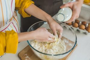couple in kitchen making dough
