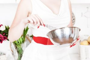 housewife with utensils in the kitchen