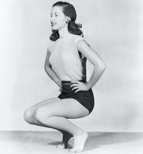 retro women doing knee bends