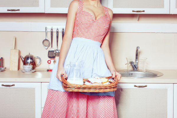 retro housewife holding breakfast tray